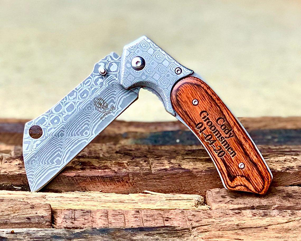 personalized Damascus blade with custom engraving