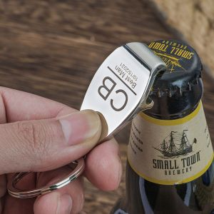 a bottle opener keychain is opening a beer
