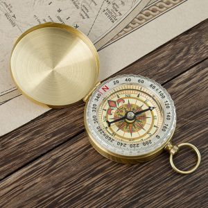 an opened gold personalized compass