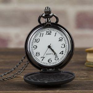an opened groomsmen pocket watch