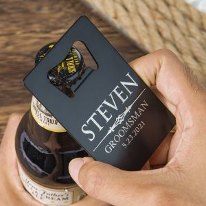 black credit card bottle opener is opening a beer