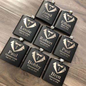 black flasks with tie design