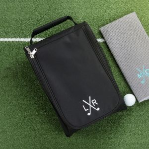 black golf shoe bag with a ball and golf towel