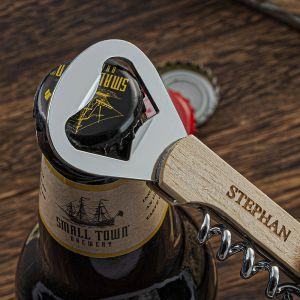corkscrew bottle opener is opening beer bottle
