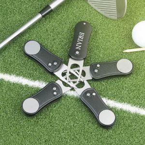 five aluminum folding golf divot tools