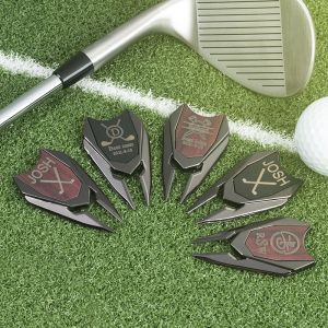 five divot tools with ball and bat