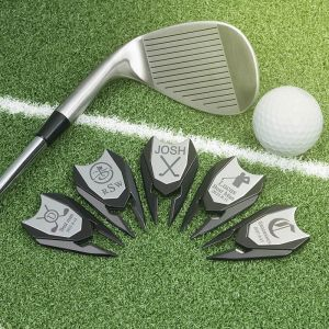five silver divot tools with ball and bat