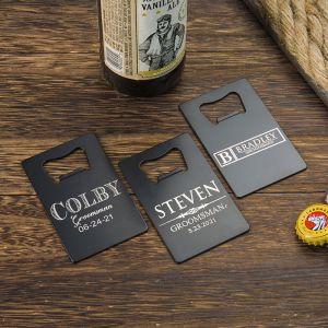 three black credit card bottle openers