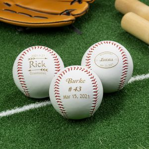 three engraved baseballs