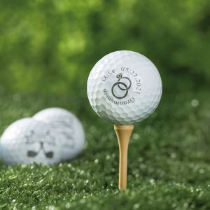 three engraved golf balls and golf tee