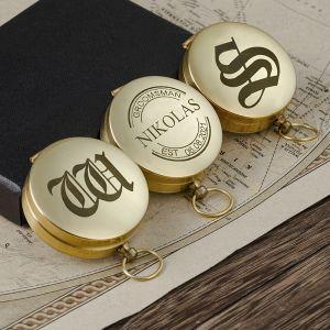 three gold groomsmen engraved compasses