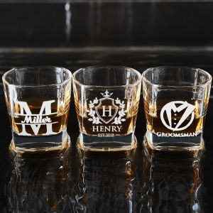 three personalized whiskey glasses