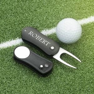 two aluminum folding golf divot tools
