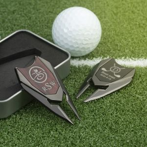 two distinct color golf divot tools with a box