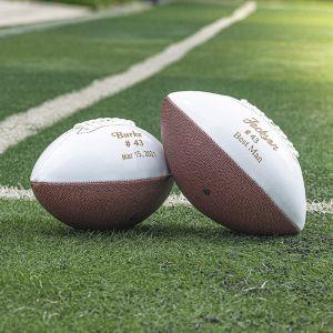 two engraved groomsmen footballs