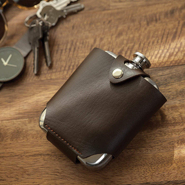 flask with a durable leather traveling case